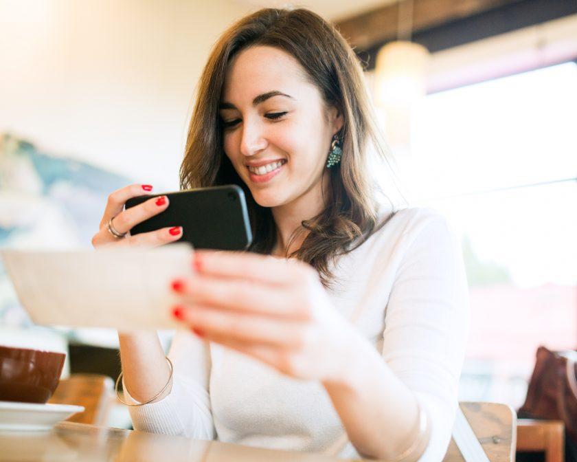 woman depositing a check-mobile deposit