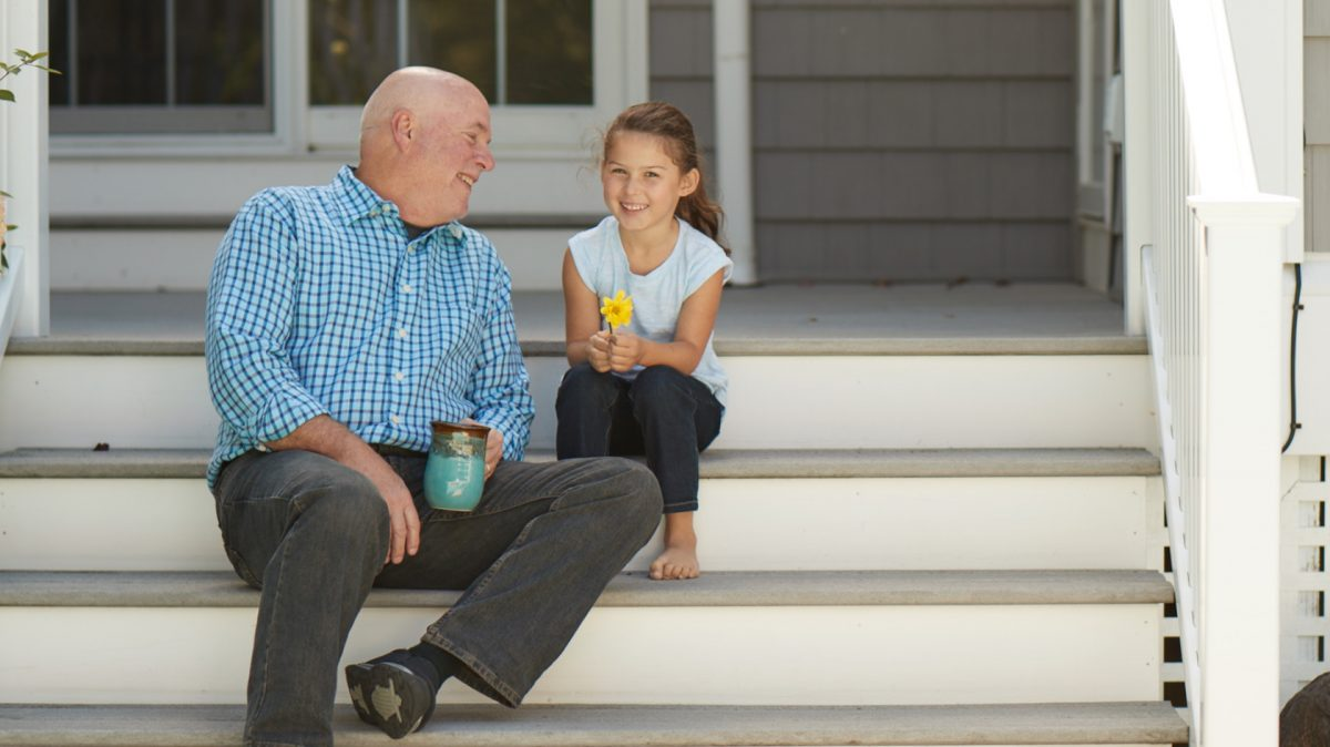man and young girl on porch