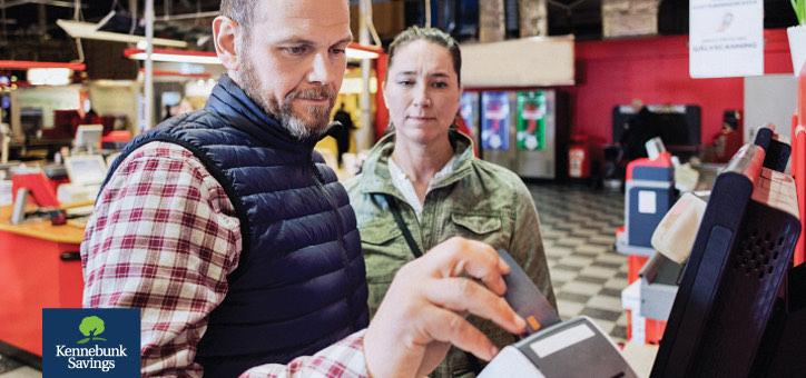 Man swiping his bank card through card-reader