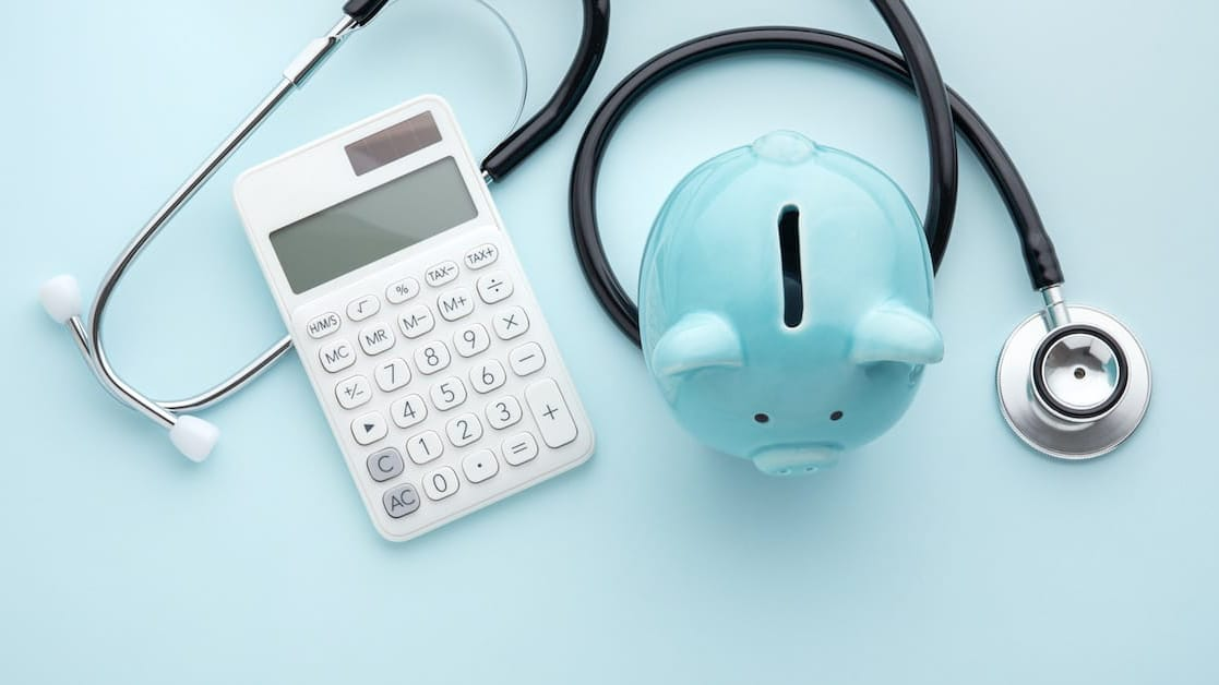 blue piggy bank and calculator