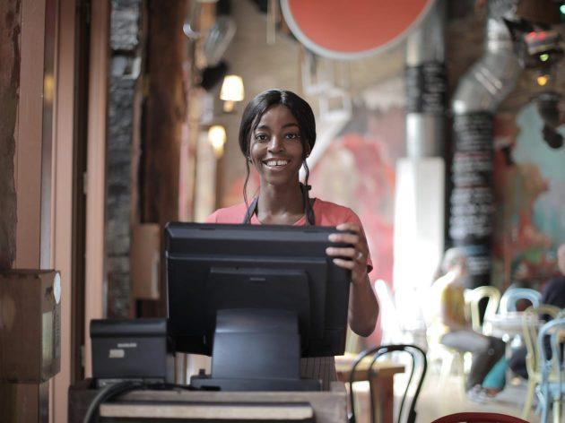 Female cashier smiling