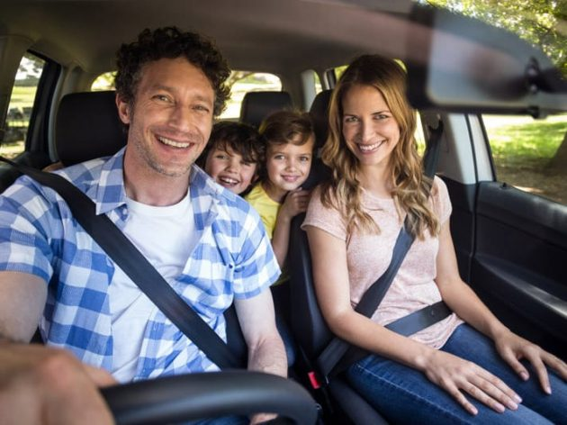 Family riding in a SUV