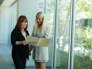 Two women talking about insurance