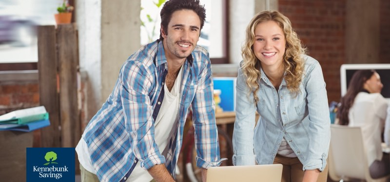 Young couple looking at laptop computer