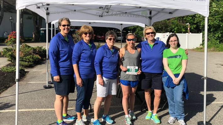 Kennebunk Savings staff standing by tent at an event
