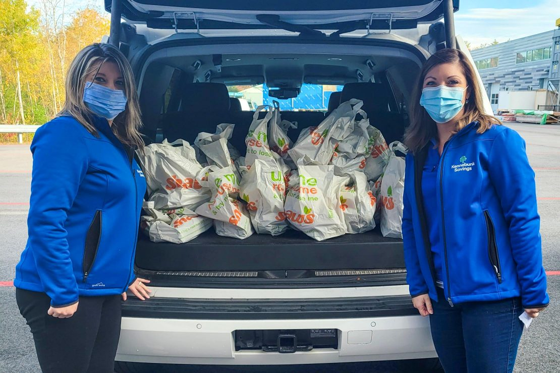 Staff with purchased groceries to donate