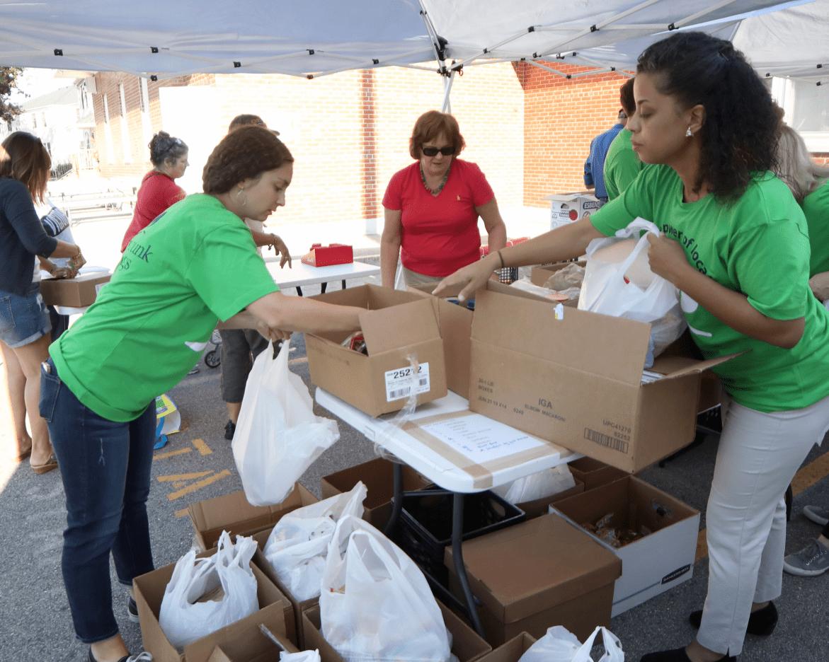People volunteering to sort items