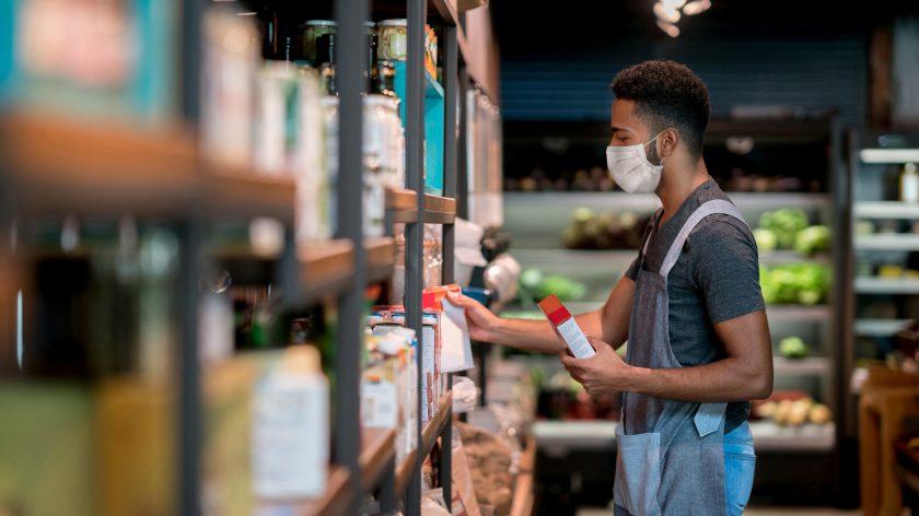 man stocking groceries