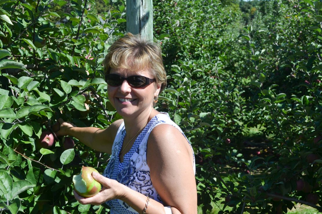 Peg Stansfield picking apples