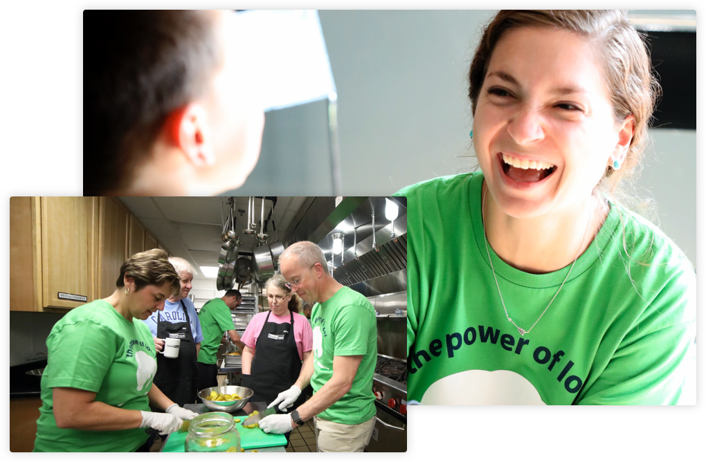 Volunteers preparing food and smiling